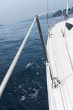 In the sailboat. Navigating in a sailboat across the mediterranean sea Royalty Free Stock Image