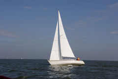 Sailboat. Sailing on open water with blue sky Stock Image