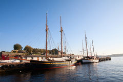 Sailboat. Two sailing ships moored on the shore Royalty Free Stock Photos