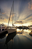 Sailboat. Docked at a marina with sunset sky in the background. HDR image stock photography