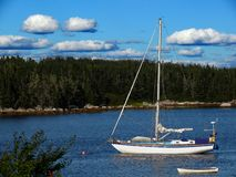Sailboat. And fishing boat in Nova Scotia, Canada stock photo