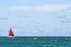 Sailboat. A sailboat sailing in the blue ocean water Royalty Free Stock Photos