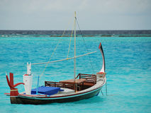 Sailboat. Lonely sailboat in the Indian Ocean, Maldives Stock Photography
