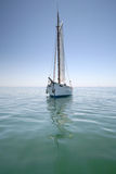 Sailboat. Sailing in the morning with blue cloudy sky Royalty Free Stock Photography