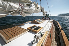 Sailboat. Beautiful yacht in the blue sea. A fresh wind and pleasant movement Stock Photos