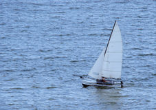 Sailboat. Alone on the sea stock photography