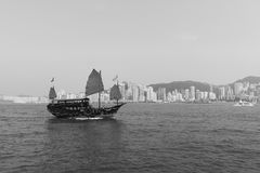 Sailboat across Victoria Harbour Royalty Free Stock Photo