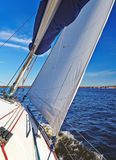 Sailboat in action, autumn cruise on the lake Royalty Free Stock Photo