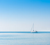 Sailboat in Adriatic sea. Copyspace background. Sailboat in Adriatic sea. Blue sky over water horizon. Copyspace background Royalty Free Stock Images
