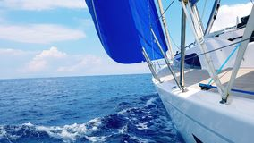 Sailboat in Aegean Sea. A sailboat with a blue genoa in the Aegean Sea stock photos