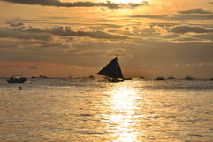 Sailboat against beautiful sunset in Boracay.  Stock Images