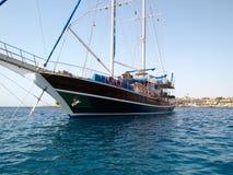 Sailboat against Egyptian shoe Stock Photo