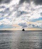Sailboat against sunset Stock Photos