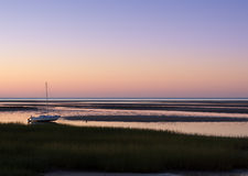 Sailboat Aground at Paine's Creek at Sunset Royalty Free Stock Image