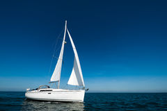 Sailboat alone Stock Images