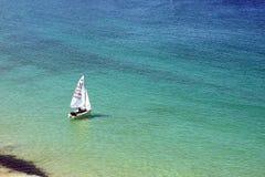 Sailboat alone in the sea Stock Image