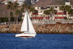 Sailboat along the coast Royalty Free Stock Images