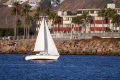 Sailboat Along The Coast Royalty Free Stock Images