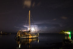 Sailboat at Anchor - Lightning Storm Stock Photos