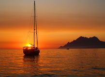 Sailboat at anchor. In Porto bay in Corsica at sunset Royalty Free Stock Images