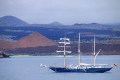 Sailboat anchored between Bartolome and Santiago islands in Gala Stock Image