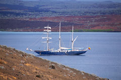 Sailboat anchored between Bartolome and Santiago islands in Galapagos Stock Photos
