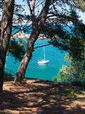 Sailboat anchored in a bay Royalty Free Stock Image