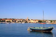 Sailboat anchored harbor Royalty Free Stock Images