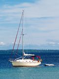 Sailboat anchored in harbor Royalty Free Stock Photography