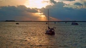 Sailboat anchored at ocean lagoon at a beautiful sunrise stock video footage