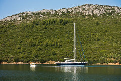 Sailboat anchored at Porto Koufo harbor at morning, west coast of Sithonia Stock Photo