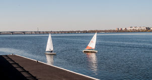 Sailboat in the background stone coast Stock Photo