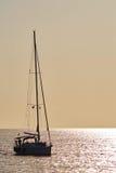 Sailboat backlit Royalty Free Stock Photos