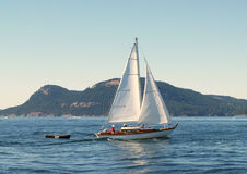 Sailboat on Bay. Sailboat with dingy on Bay Royalty Free Stock Photos