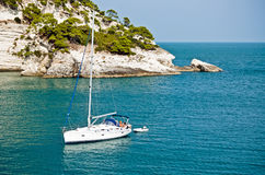 Sailboat in the bay. In south Italy royalty free stock images