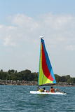 Sailboat in the bay. Very small sailboat coming into the bay on lake Michigan Royalty Free Stock Photos