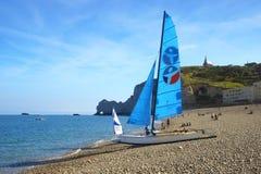 Sailboat on a bay beach Cote d'Albatre. Stock Photos