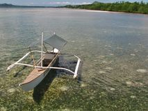 Sailboat in a bay with corals on the Philippines. stock photos