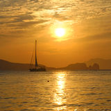 Sailboat on bay at sunset. Sailboat on Klima Bay at sunset. Milos Island, Southern Cyclades, Greece Stock Photos