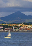 Sailboat in the Bay of Txingudi and Hendaye Royalty Free Stock Photography