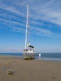 Sailboat on beach, Wadden Sea, Netherlands Stock Image
