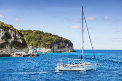 Sailboat in a beautiful bay, Greece. Sailboat in a sunny day, Greece islands Royalty Free Stock Image