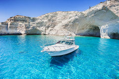 Sailboat in a beautiful bay, Milos island, Greece. Beautiful view of sailboat against white rock, Milos island, Greece Royalty Free Stock Photography
