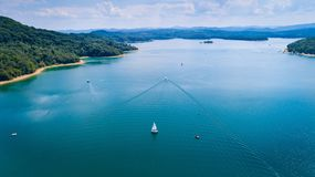 Sailboat on beautiful Solina lake. In Polish Bieszczady Mountains. Solina, Poland royalty free stock image