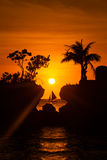 Sailboat at beautiful sunset above the tropical sea. Silhouette Royalty Free Stock Image