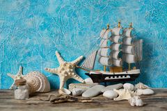 Sailboat on a blue background Stock Photos
