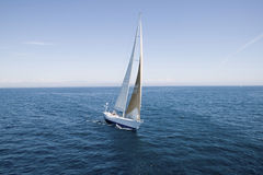 Sailboat At The Blue Ocean Against Sky Royalty Free Stock Images