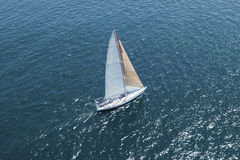Sailboat At The Blue Ocean Royalty Free Stock Photography
