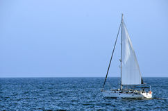 Sailboat blue sea Stock Images