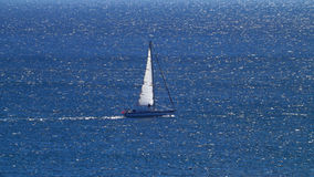 Sailboat in the blue sea Royalty Free Stock Photos